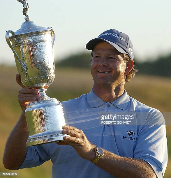 Retief Goosen of South Africa smiles as he looks at his 104th US Open Championship trophy at the Shinnecock Hills Golf Club in Southampton NY 20 June...