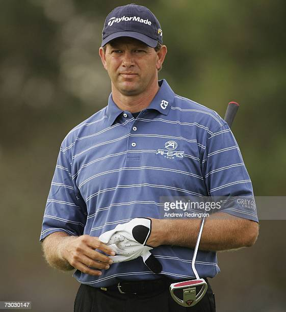 Retief Goosen of South Africa waits on the 12th hole during the first round of The Abu Dhabi Golf Championship at Abu Dhabi Golf Club on January 18...