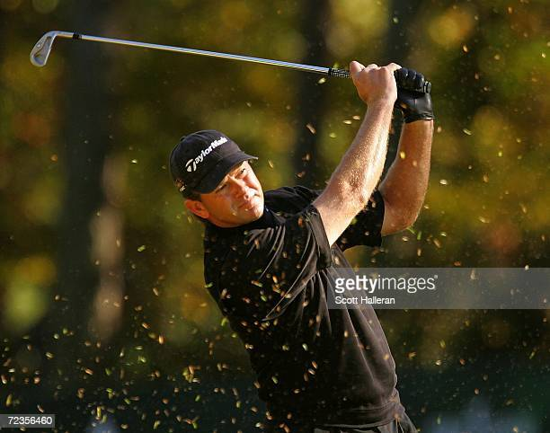 Retief Goosen of South Africa watches his approach shot on the 16th hole during the first round of the Tour Championship at East Lake Golf Club on...