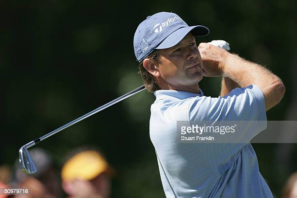 Retief Goosen of South Africa watches his tee shot on the fourth hole during the final round the 104th U.S. Open at Shinnecock Hills Golf Club on...