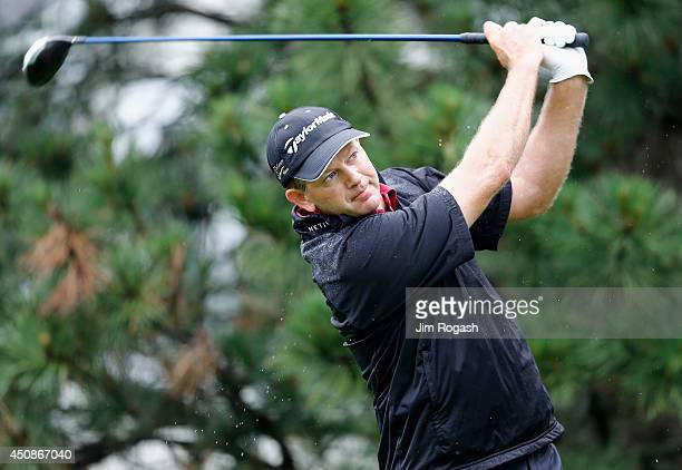 Retief Goosen of South Africawatches his tee shot on the sixth hole during the first round of the Travelers Championship golf tournament at the TPC...