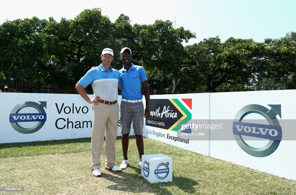 Retief Goosen poses with Siyanda Mwandla from Shakaskraal Township as he hosts a development golf clinic for 28 of the South African Golf Development Board's young golfers from KwaMashu, Cato Crest, Umhlali and Mwandla's hometown of Shakaskraal during the Pro-Am for the Volvo Golf Champions at Durban Country Club on January 9, 2013 in Durban, South Africa.