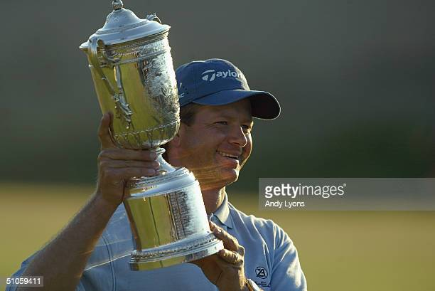 Retief Goosen poses with the trophy after winning the 104th U.S. Open at Shinnecock Hills Golf Club on June 20, 2004 in Southampton, New York.