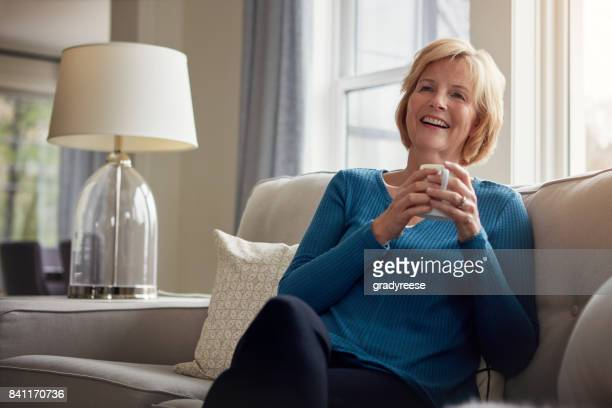 retire with a smile - one senior woman only stock pictures, royalty-free photos & images