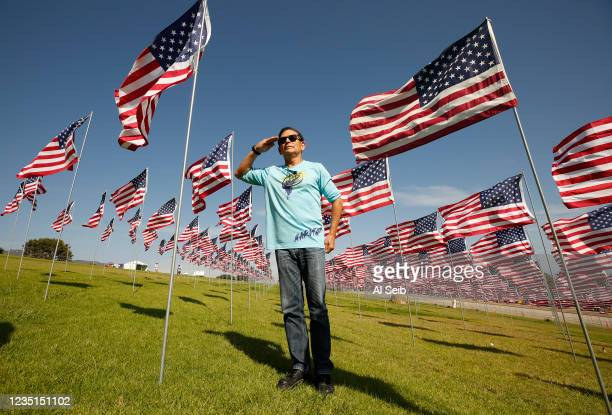 Retired Air Force Colonel Alfredo Garcia from Lomita with his wife Idaila salutes the flags To pay my respect as they visit for the first time the...