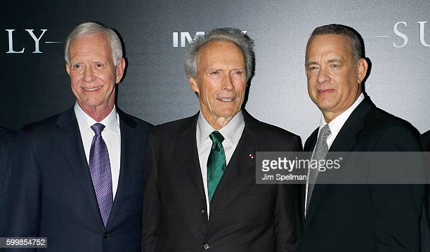"""Retired airline captain Chesley """"Sully"""" Sullenberger, director Clint Eastwood and actor Tom Hanks attend the """"Sully"""" New York premiere at Alice Tully..."""