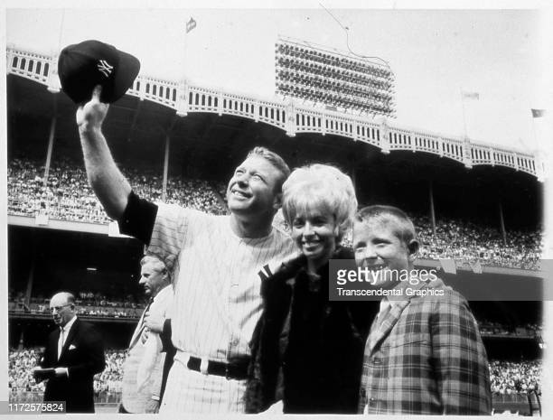 Retired American baseball player Mickey Mantle , of the New York Yankees, along with his wife, Merlyn Mantle , and son, Mickey Mantle Jr , waves to...