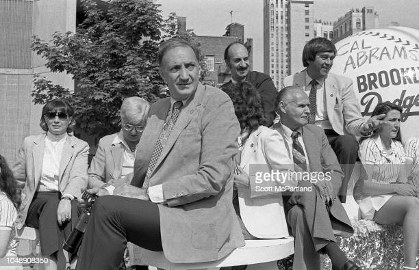 Retired American baseball players Ralph Branca and Cal Abrams both of the Brooklyn Dodgers sit with unidentified others on their former team's parade...
