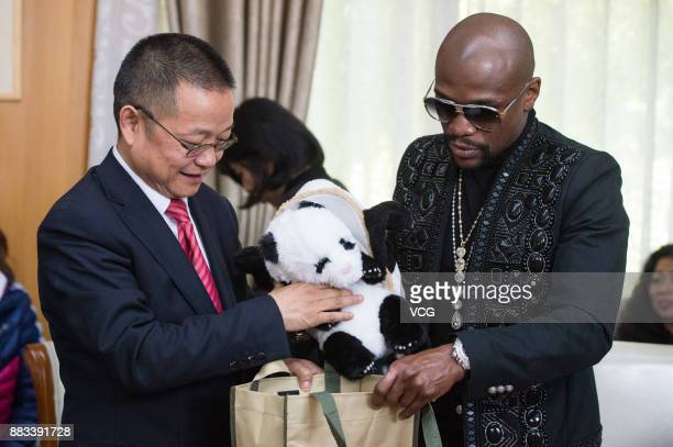 Retired American boxer Floyd Mayweather Jr attends the ceremony as he adopts a giant panda 'TMT Floyd Mayweather' at the Chengdu Research Base of...