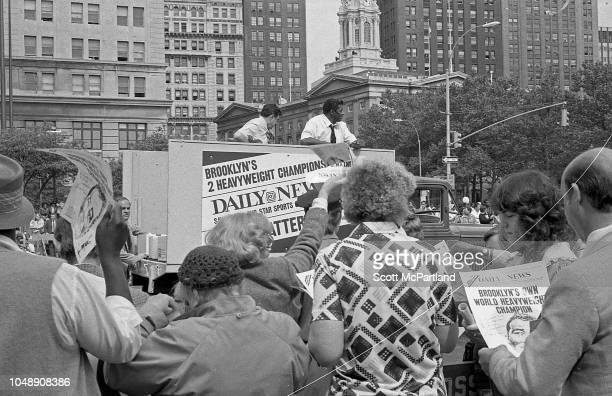 Retired American heavyweight boxer Floyd Patterson rides in a New York Daily News truck during the Brooklyn Bridge's 100th birthday celebrations in...