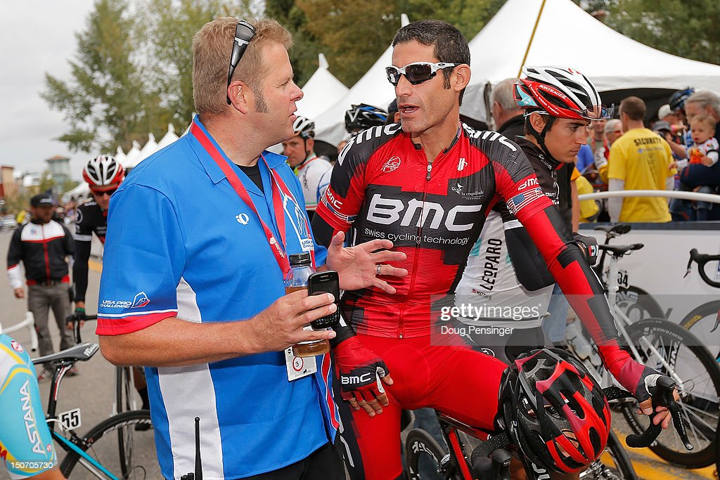 Retired American pro cyclist Ron Kiefel talks with George Hincapie riding for BMC Racing prior to the start of stage five of the USA Pro Challenge from Breckenridge to Colorado Springs on August 24, 2012 in Breckenridge, Colorado.