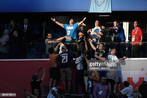 TOPSHOT Retired Argentina forward Diego Maradona reacts before the Russia 2018 World Cup Group D football match between Nigeria and Argentina at the...