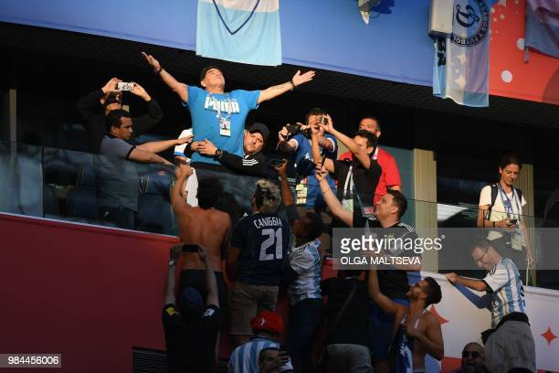 TOPSHOT Retired Argentina player Diego Maradona gestures ahead of the Russia 2018 World Cup Group D football match between Nigeria and Argentina at...