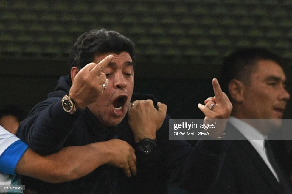 TOPSHOT - Retired Argentina player Diego Maradona gestures during the Russia 2018 World Cup Group D football match between Nigeria and Argentina at the Saint Petersburg Stadium in Saint Petersburg on June 26, 2018. (Photo by OLGA MALTSEVA / AFP) / RESTRICTED