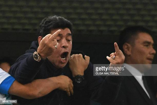 TOPSHOT Retired Argentina player Diego Maradona gestures during the Russia 2018 World Cup Group D football match between Nigeria and Argentina at the...
