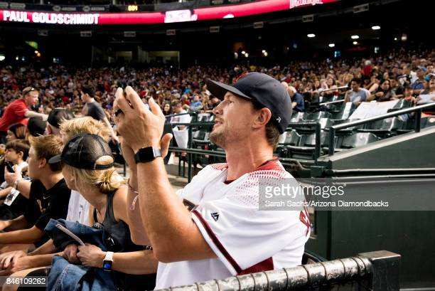Retired Arizona Coyotes player Shane Doan cheers on the Arizona Diamondbacks during a game against the San Diego Padres at Chase Field on September 9...