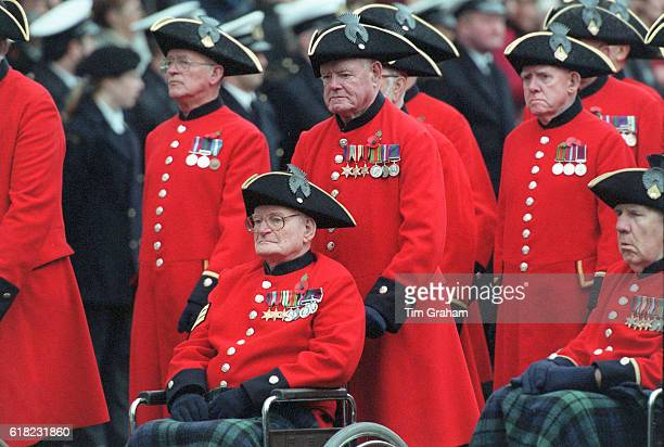 Retired army veterans Chelsea Pensioners the disabled in wheelchairs take part in parade at the Cenotaph