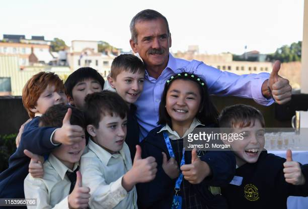 Retired astronaut Chris Hadfield poses for photos after he speaks with school children during the Amplify festival at Museum of Contemporary Art on...