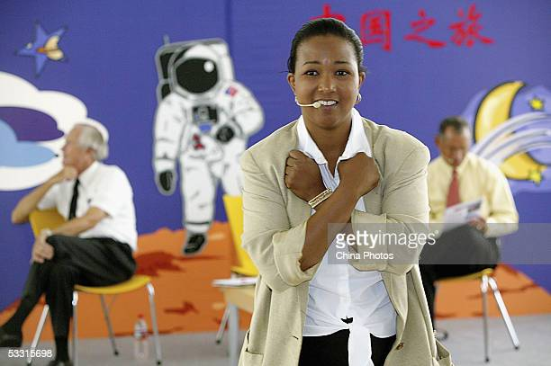 US retired astronaut Mae C Jemison delivers a speech to workers and children as she visits a research center of DuPont Company with the other two...