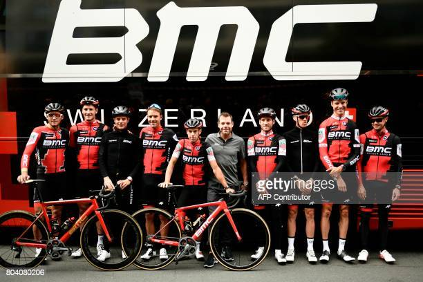 Retired Australia's cyclist BMC's former rider Cadel Evans poses for photographers with riders of the USA's BMC Racing cycling team Belgium's Greg...