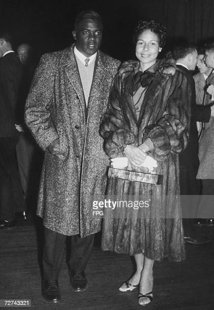 Retired baseball player Jackie Robinson and his wife Rachel at the Seventh Regiment Armory to attend a benefit tennis match for Art Larsen who was...