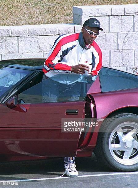 Retired basketball star Michael Jordan arrives at the Berto Center the Chicago Bulls practice facility in Deerfield Illinois 18 March Jordan has...