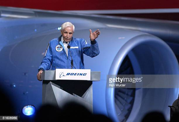 Retired Boeing Co pilot Lew Wallick who copiloted the first flight of the Boeing 757 gestures as he addresses employees at a ceremony marking the...