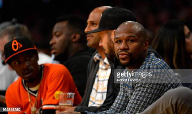 Retired boxer Floyd Mayweather watches the game betwee the Denver Nuggets and the Los Angeles Lakers on March 13 2018 at STAPLES Center in Los...
