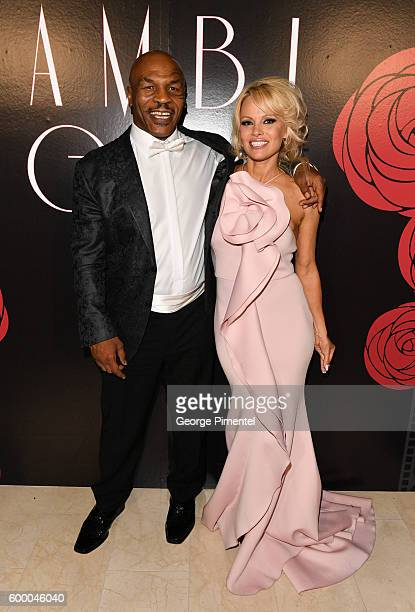 Retired boxing champion Mike Tyson and Pamela Anderson attend the 2016 Toronto International Film Festival 'AMBI Gala' at Ritz Carlton on September 7...