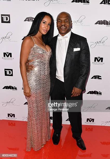 Retired boxing champion Mike Tyson and wife, Kiki Tyson attend the 2016 Toronto International Film Festival 'AMBI Gala' at Ritz Carlton on September...