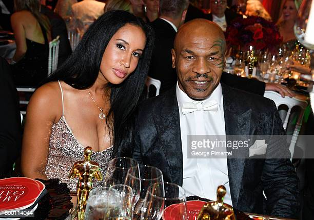Retired boxing champion Mike Tyson and wife Kiki Tyson attend the 2016 Toronto International Film Festival 'AMBI Gala' at Ritz Carlton on September 7...