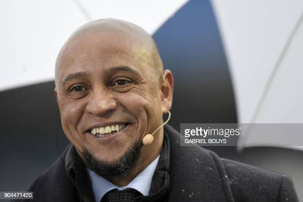 Retired Brazilian defender Roberto Carlos smiles ahead of the Spanish league football match between Real Madrid and Villarreal at the Santiago...