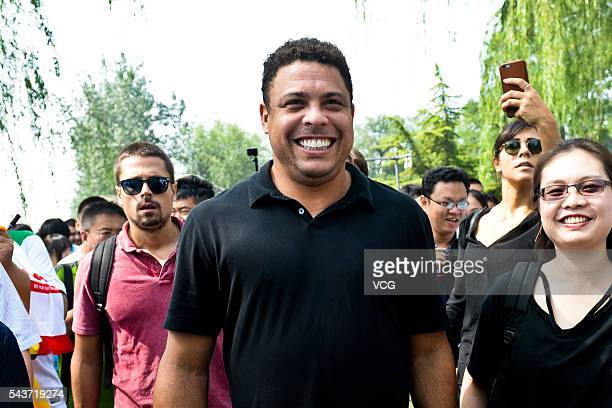 Retired Brazilian footballer Ronaldo Luis Nazario de Lima attends football activity at Beijing 101 Middle School on June 30 2016 in Beijing China...
