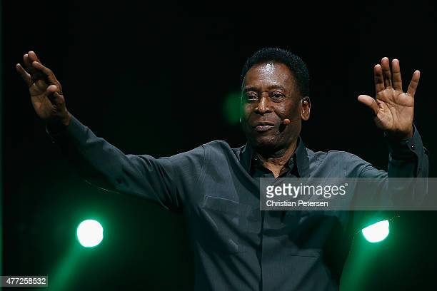 Retired Brazilian professional footballer Pele waves to fans as he leaves the Electronic Arts E3 press conference at the LA Sports Arena on June 15...