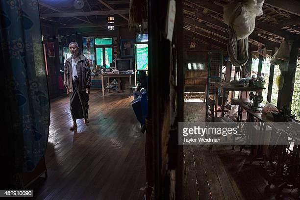 A retired Burmese government worker paces through his house near the Dawei SEZ on August 4 2015 in Pantininn Myanmar The controversial multibillion...