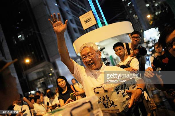 Retired cardinalate Joseph Zen Ze-kiun waves at protesters during the annual pro-democracy protest on July 1, 2014 in Hong Kong. July 1, 2014 marks...