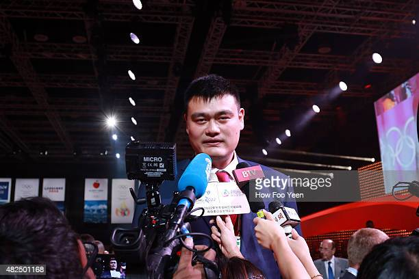 Retired Chinese professional basketball player and member of the Chinese delegation Yao Ming speaks to the press after Beijing China was announced as...