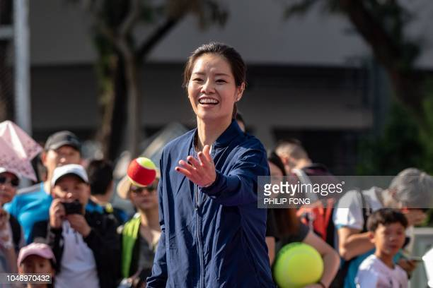 Retired Chinese tennis player Li Na performs during the 'Kids Participation Day' in Prudential Hong Kong Tennis Open 2018 on October 7 2018