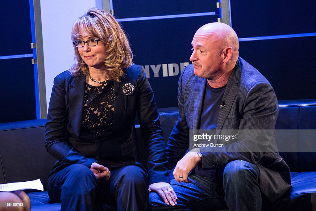 Retired Congresswoman Gabby Giffords (L) and her husband, retired astronaut Mark Kelly, both co-founders of Americans for Responsible Solutions, speak at New York Ideas, a conference that brings together leaders from a variety of industries on May 6, 2014 in New York City. New York Ideas is hosted by The Atlantic, The Aspen Institute and New-York Historical Society.