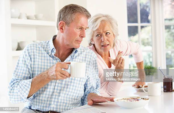 retired couple arguing at breakfast - monkey eating paper stock pictures, royalty-free photos & images