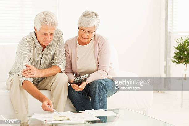 Retired couple discussing the budget