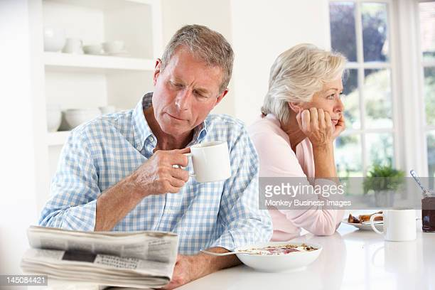 retired couple eating breakfast - monkey eating paper stock pictures, royalty-free photos & images