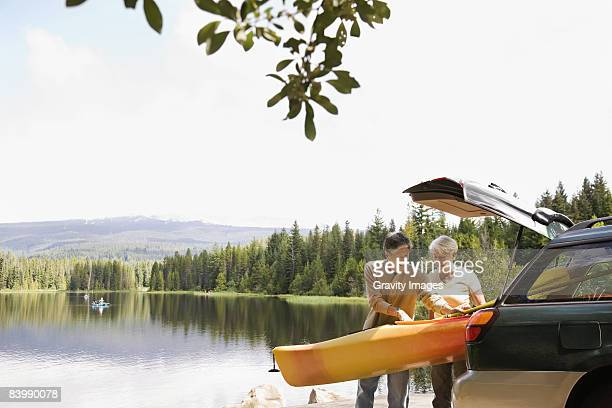 retired couple getting ready to kayak - nature stock pictures, royalty-free photos & images
