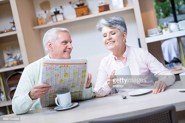 Retired couple having coffee at a cafe