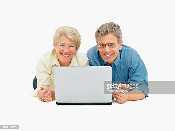 Retired couple looking at laptop together