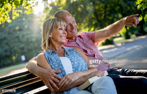 Retired couple looking very happy outdoors