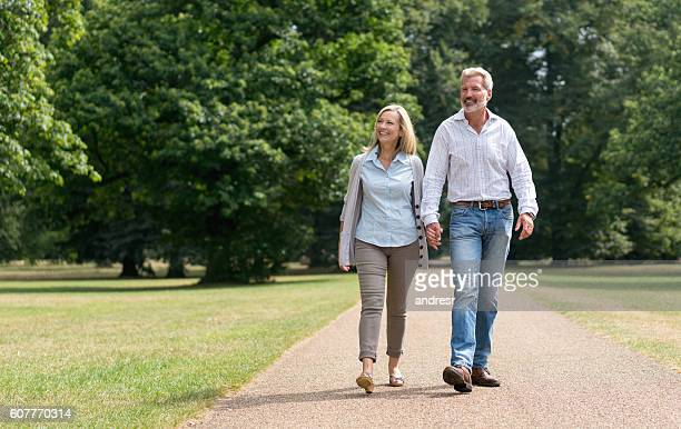 Retired couple walking at the park