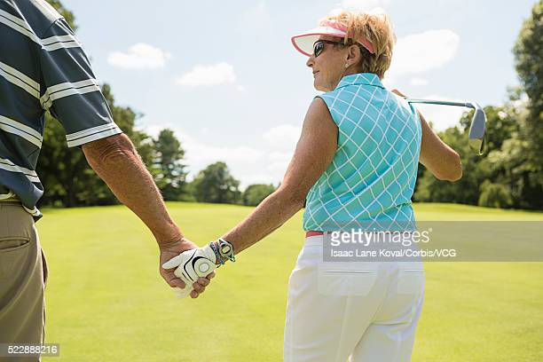 Retired couple walking on the golf course