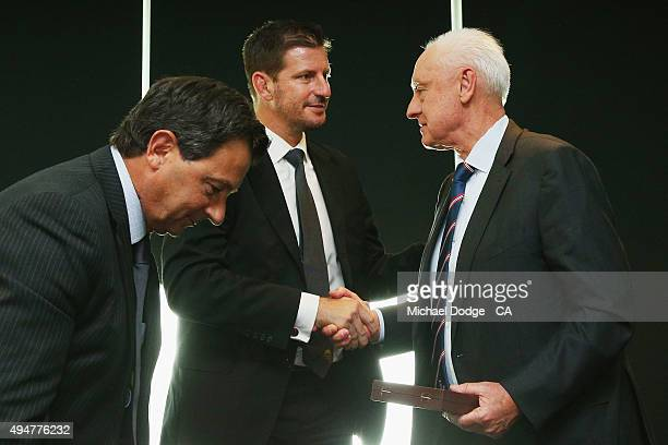 Retired Cricket Australia Chairman Wally Edwards shakes the hand Cricket Australia board member Michael Kasprowicz after his speech during the...