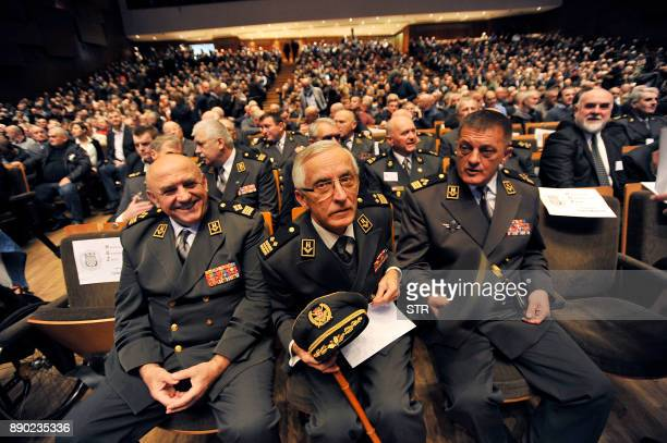 Retired Croatian Army officers gather before the start of a commemoration ceremony honouring the late Croatian general Slobodan Praljak in Zagreb on...